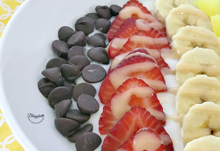 Banana Split Smoothie Bowl - close up with Barlean's Omega Pals drizzled over top