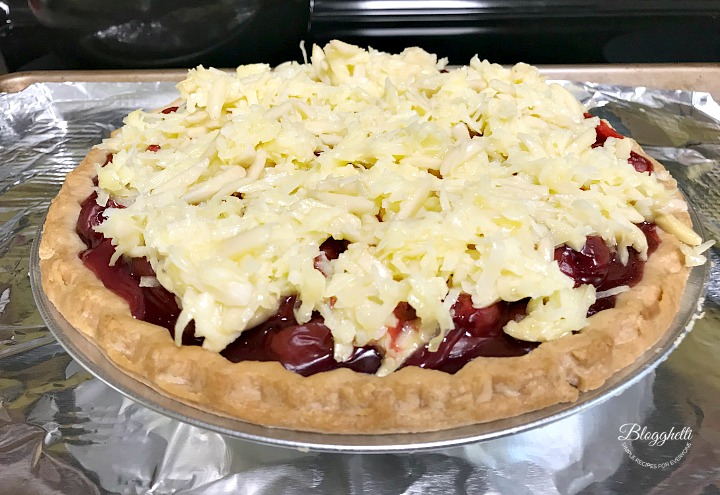 Macaroon Cherry Pie ready to bake in oven