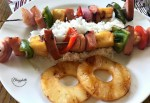 Grilled Hawaiian Ham Skewers with rice and pineapple on a white plate