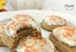 Close up of soft pumpkin cookies with cream cheese frosting