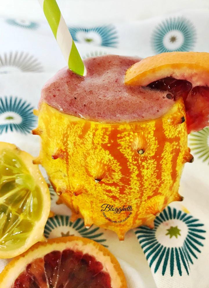 kiwano melon and blood orange smoothies in kiwano shell - close up