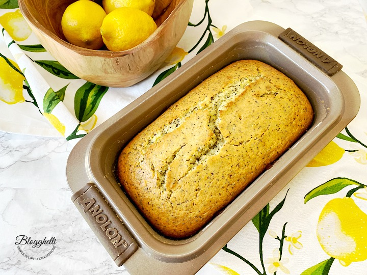 fresh out of the oven lemon poppy seed loaf in baking pan