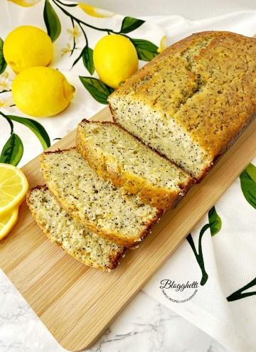 slices of lemon poppy seed bread on wooden board