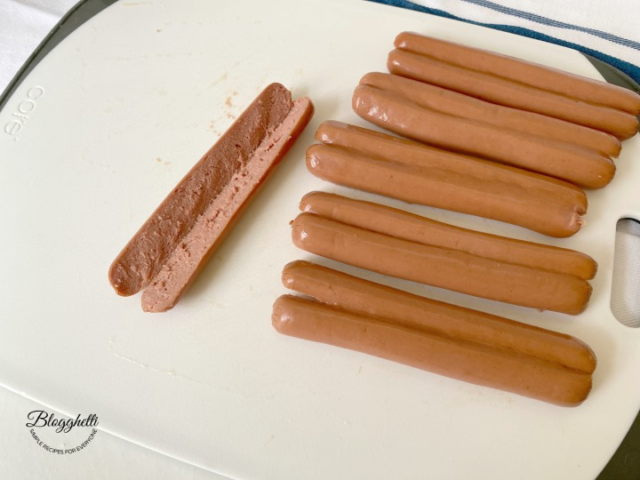 cutting hot dogs in half lengthwise