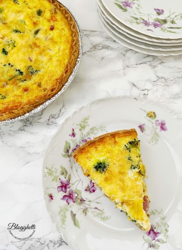 slice of Broccoli and Ham quiche on flowered china plate