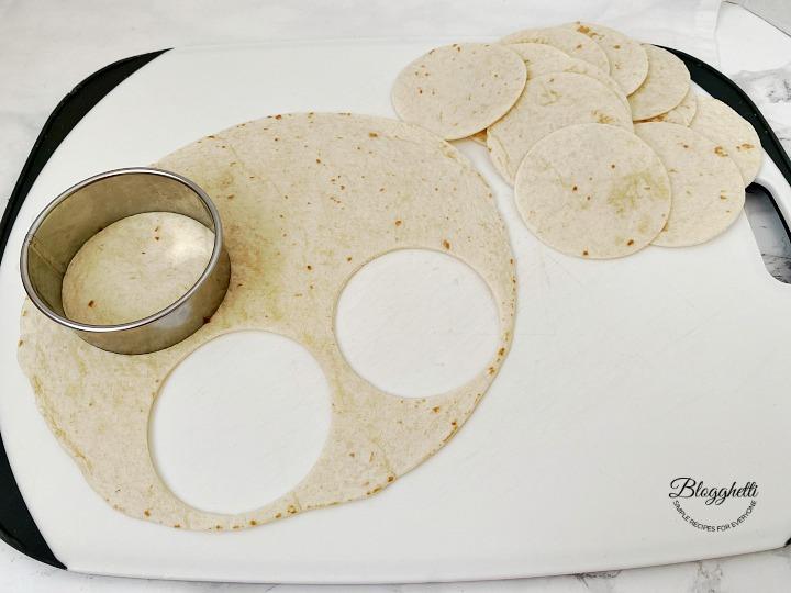 Cutting mini taco shells from tortillas
