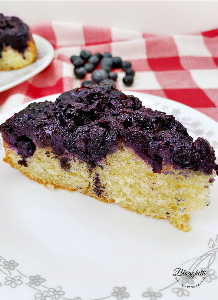 slice of blueberry upside down cake on plate