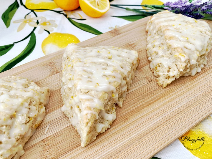 close up of lemon lavender scones with glazed on wooden board