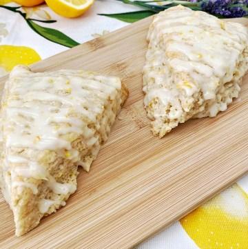 glazed lemon lavender scones on wooden board