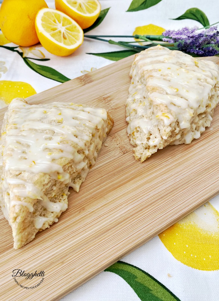 glazed lemon lavender scones on wooden board