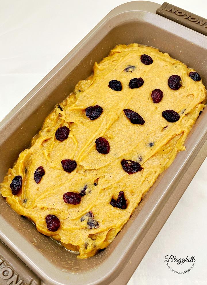 pumpkin cranberry bread batter in baking pan