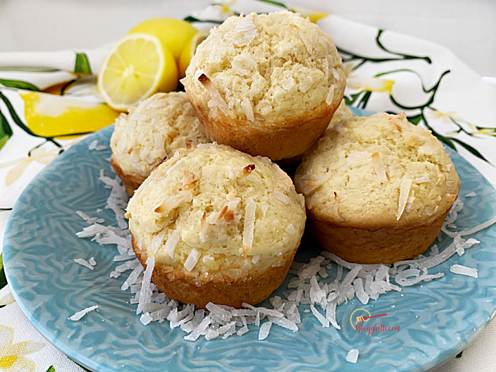 close up of lemon coconut muffins on blue plate