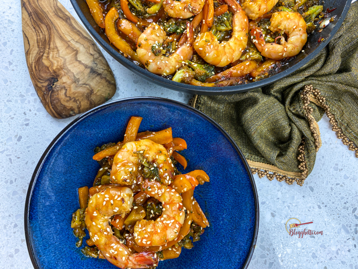 spicy honey garlic shrimp on blue plate