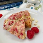 white chocolate raspberry scones on plate with books in background