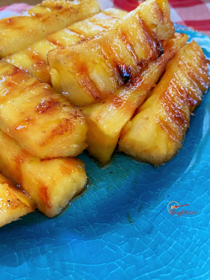close up of grilled pineapple with maple syrup glaze