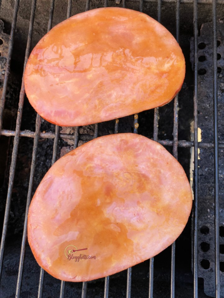 ham steaks on grill with glaze
