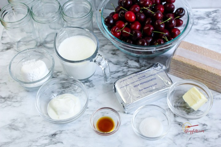Ingredients for cheesecake in a jar on counter