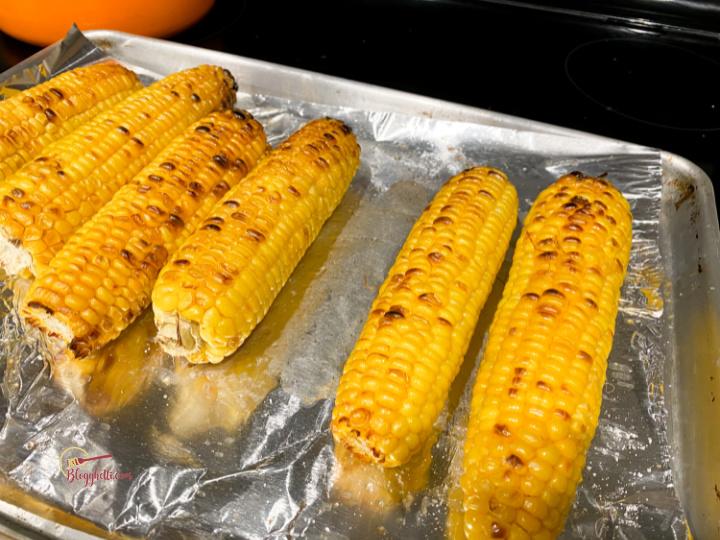 broiled charred corn on baking sheet