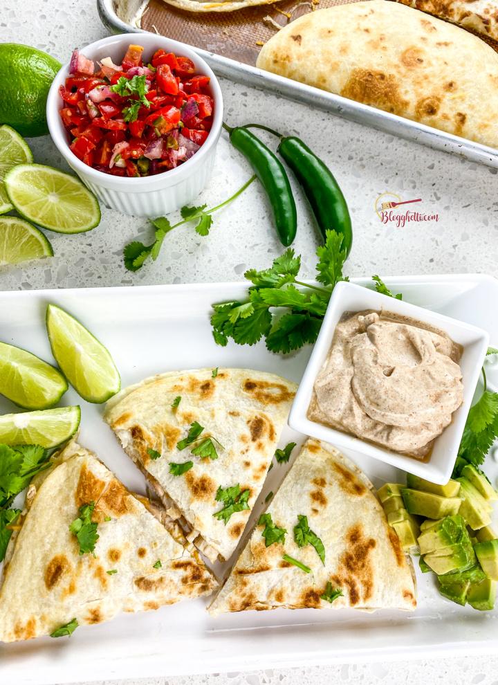 serving tray with chicken quesadillas and fresh pico de gallo
