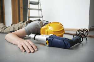 Manual worker is injured during drilling on the ladder