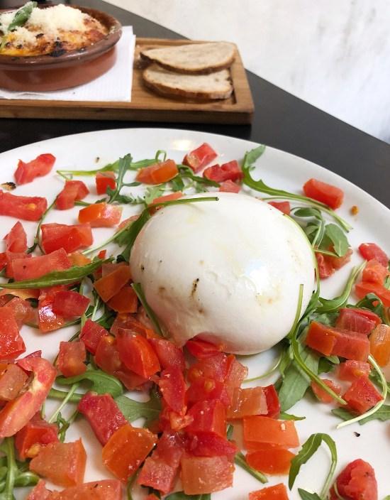 Burrata de tomate y rúcula