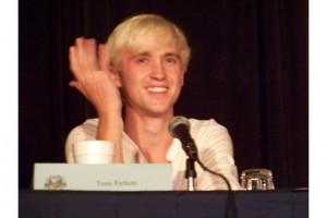 Tom Felton sonriendo