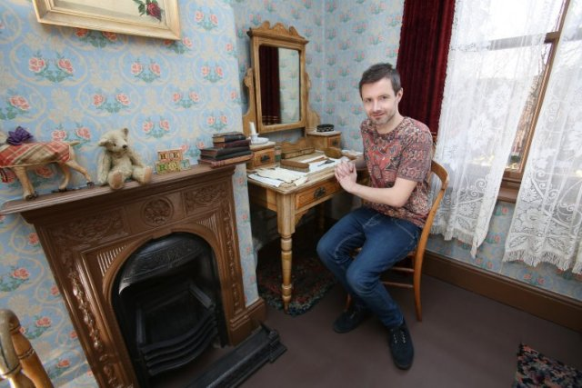 "Peter Saunders of Nottingham at his home where he lives in the 1920's. See Masons copy MNHOUSE: A man's obsession with restoring his Victorian era house has become so extreme that major movie studios are relying on him for inspiration. Peter Saunders, 36, has obsessively spent 11 years restoring his cottage to its original Victorian character and his house has now inspired a set design for the upcoming Harry Potter spin-off film. Peter, a county council press officer, has lived in his four-bedroom Nottinghamshire cottage since 2004. He said: ""The most exciting development recently was when I found a scrap of wallpaper in the second bedroom. I kept it and took it to a historic wallpaper reproduction company."