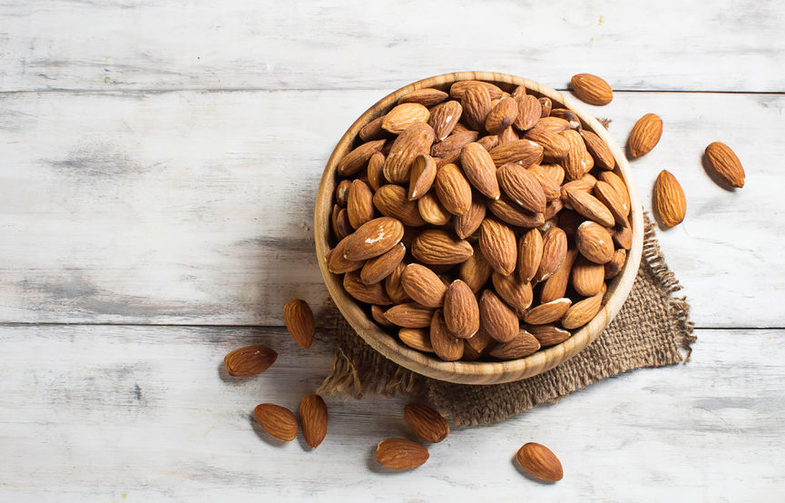 37041638 - almonds in brown bowl on wooden background