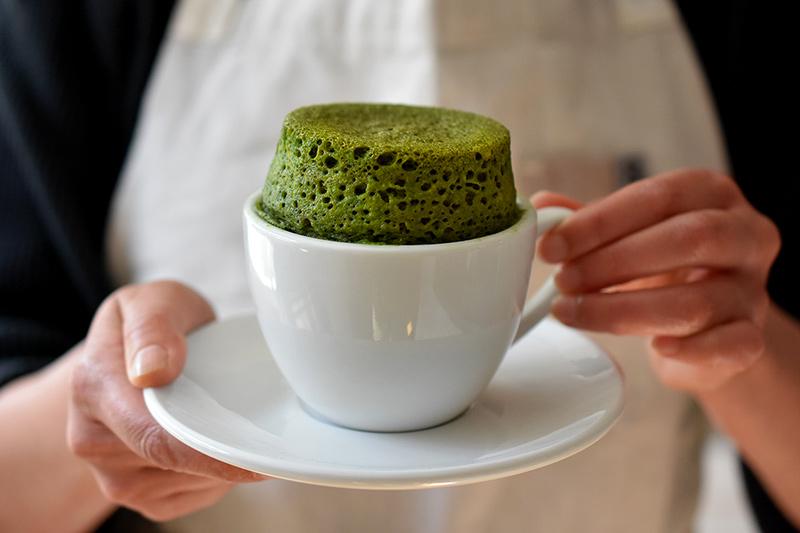 matcha cake in a white mug