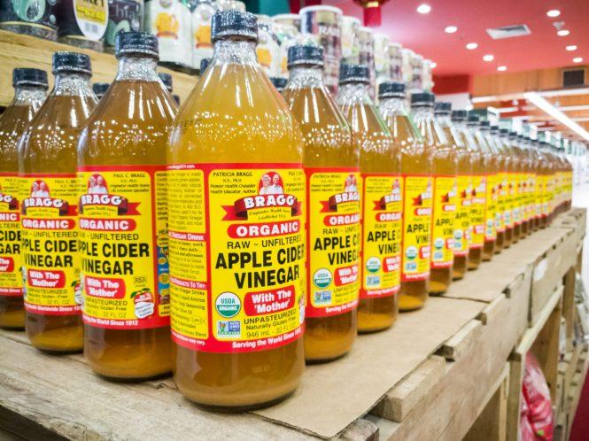 apple cider vinegar glass bottles on shelf