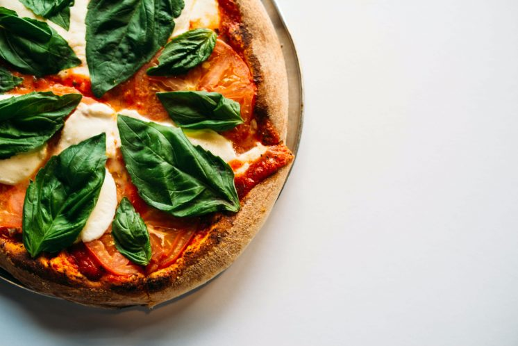 pizza with basil cheese white background favorite food