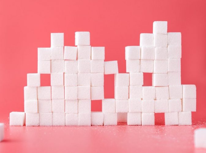 sugar cubes stacked pink background