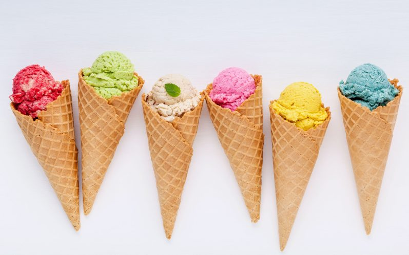 colorful ice cream waffle cones on white background