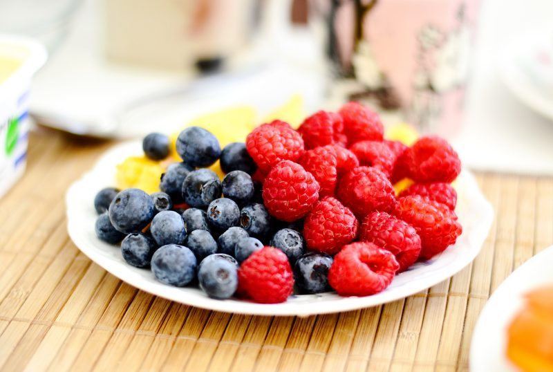 blueberries and raspberries on a white plate