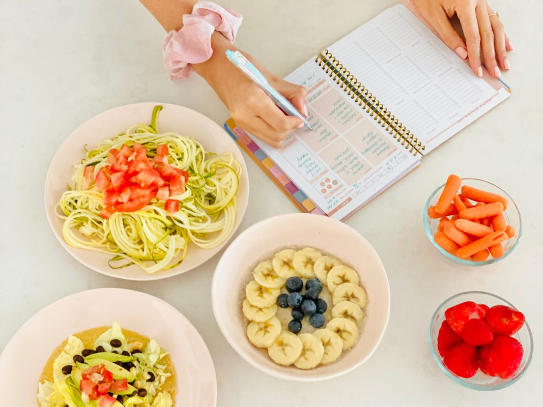 bowls of healthy food zoodles banana oatmeal berries carrots meal prep pad