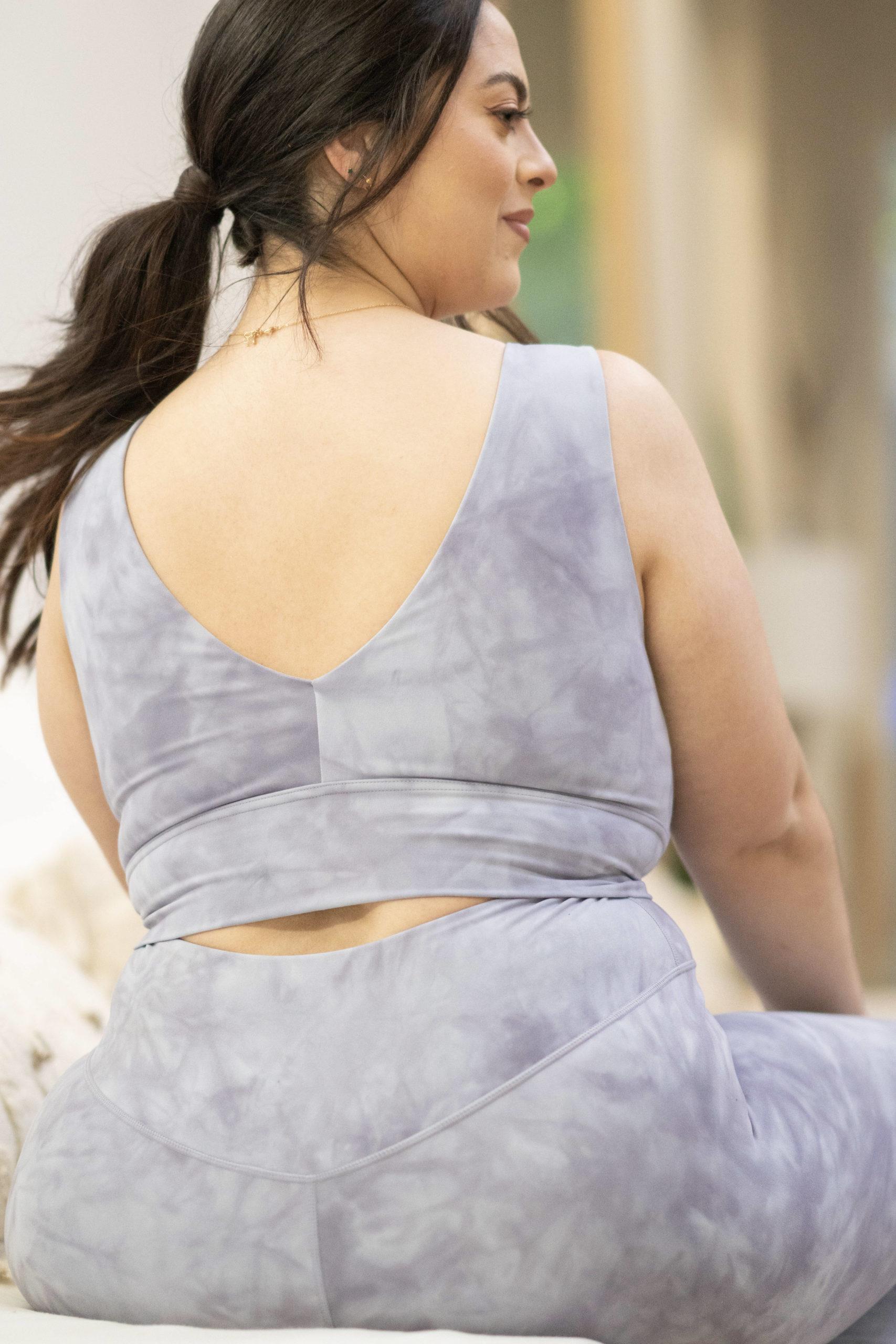 model wearing popflex marble vivid crop top bra lavender view of back deep v
