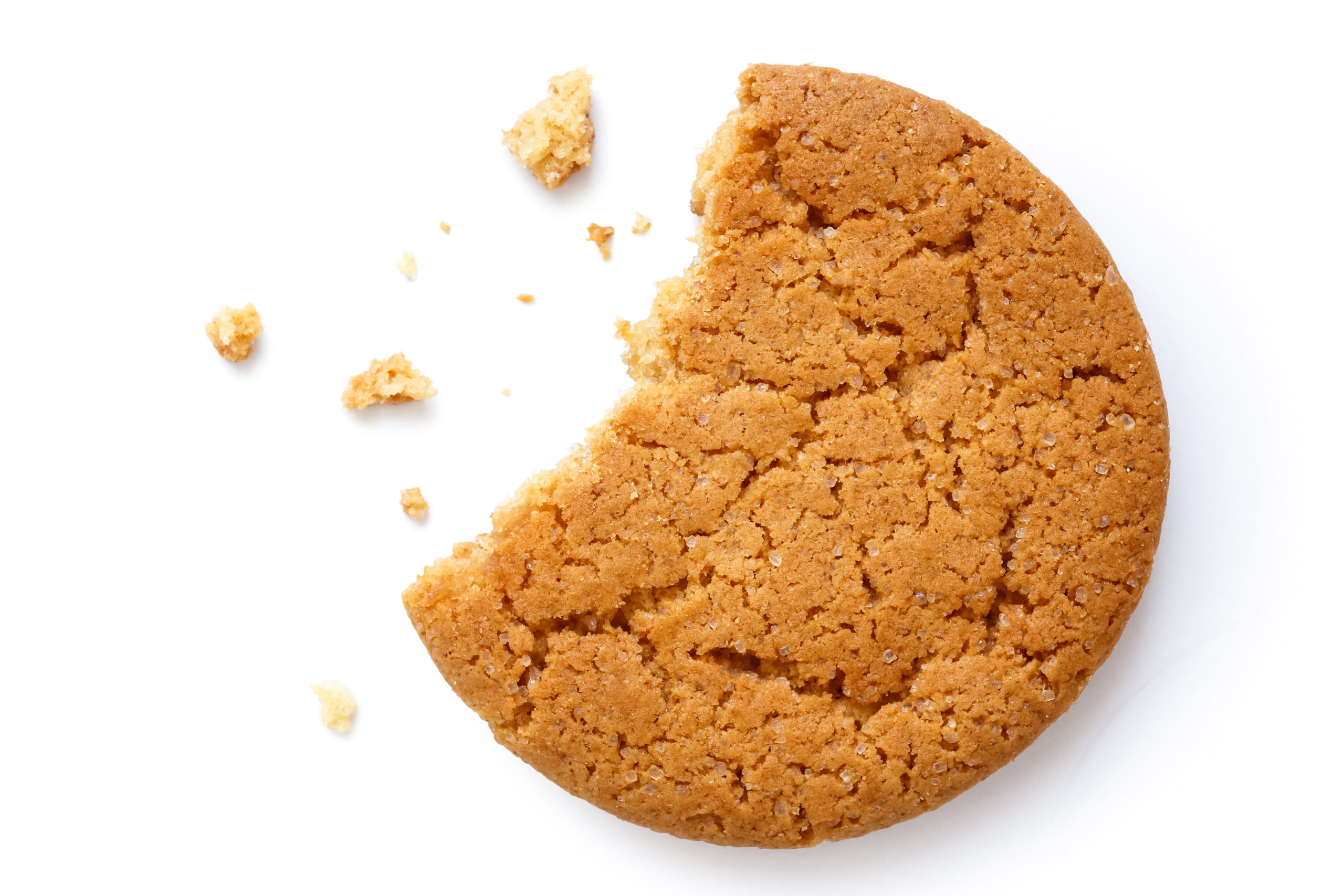 ginger cookie with bite taken out and crumbs