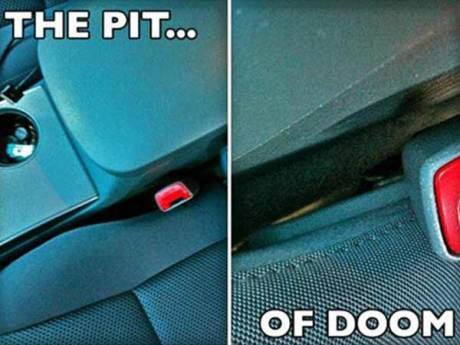 THE PIT... OF DOOM!  (The space between the car seat and console)