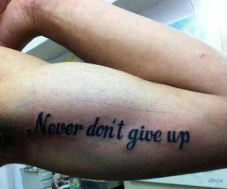 "Bad Tattoo: ""Never Don't Give Up."""