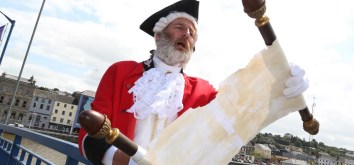 NO REPRO FEE Joe Delaney 'Town Crier' took to the streets of New Ross, Co.Wexford to practice reading the 'Declaration of Independence' ahead of July 4 Irish America Day celebrations which will take place in the county Wexford town. Picture: Mary Browne