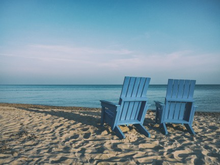 empty chairs on peaceful beach