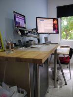 An IKEA EFFEKTIV filing cabinet fits snugly under my workstation