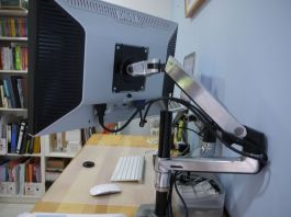 A view of the Ergotron arm attaching to the display VESA mount