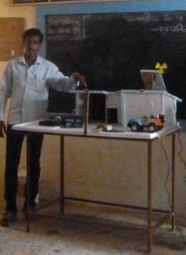 One of our instructors with his innovation, a solar energy powered toy car