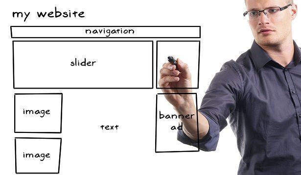 man drawing website wireframe