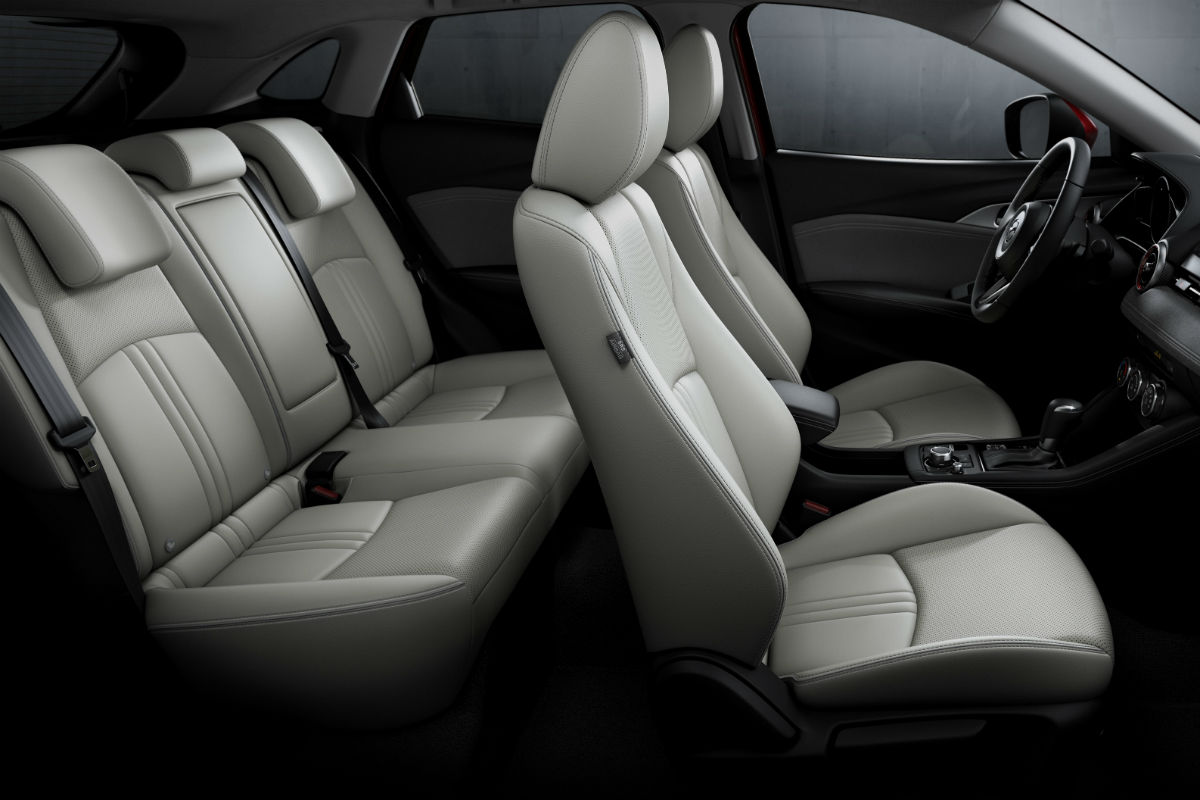 hight resolution of side view of the two rows of seating in the 2019 mazda cx 3