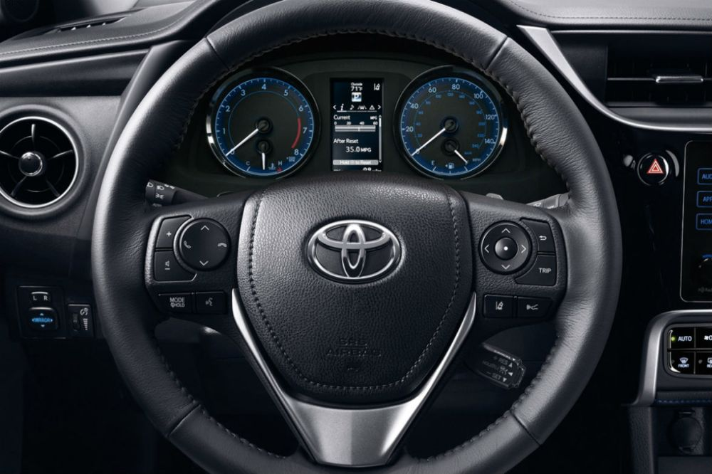 medium resolution of steering wheel and driver info display of the 2018 toyota corolla