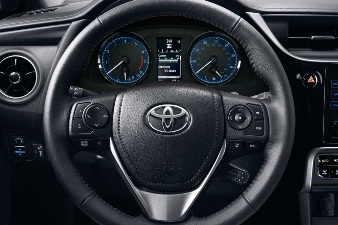 hight resolution of steering wheel and driver info display of the 2018 toyota corolla