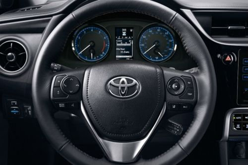 small resolution of steering wheel and driver info display of the 2018 toyota corolla