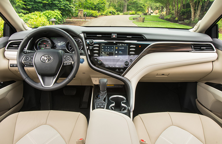 brand new toyota camry hybrid foto grand veloz how far can you drive in the 2018 interior view of a showing tan seating and steering wheel